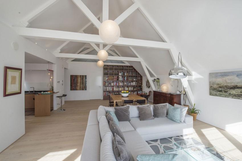 Un nuovo look moderno e pulito per una casa nel cuore for Progetto appartamento moderno