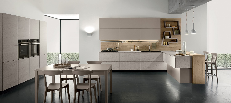 Cucine con penisole pin cucina con penisola in muratura for Soggiorno in stile new england
