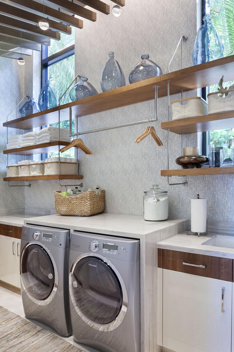 L'ispirazione da una lavanderia in una casa costruita da Mark Timothy, Inc con interni di design d'interni di Marc Michael e mobili di Superior Wood Products .